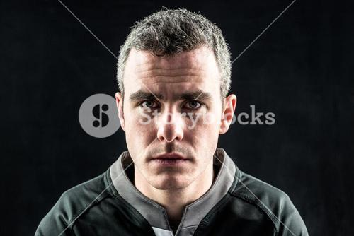 A rugby player looking at the camera