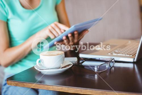 A woman using tablet computer