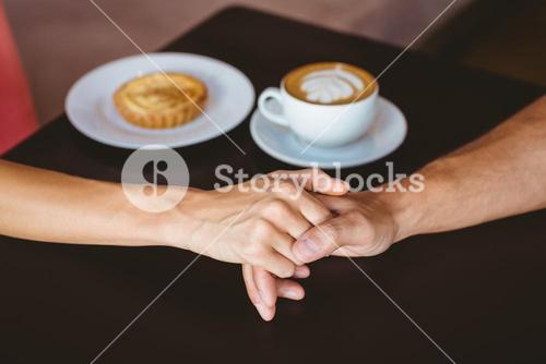 Cute couple on a date holding hands