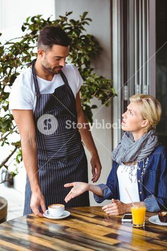 Pretty blonde arguing with the waiter
