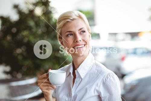 Cafe owner smiling at the camera