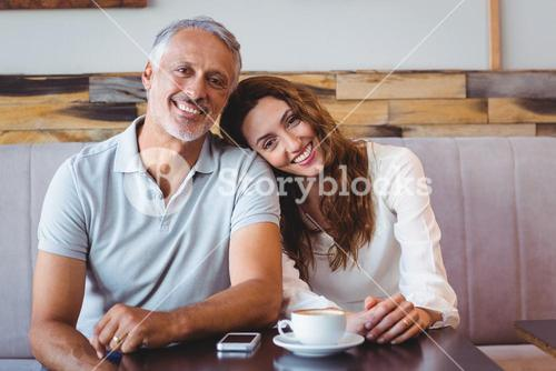 Cute couple drinking coffee