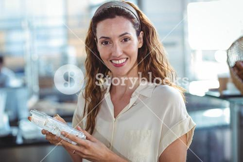 Pretty woman shopping in the bakery
