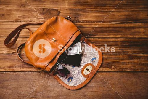 Sunglasses and wallet on the vintage bag