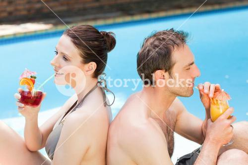 Couple drinking cocktails back-to-back