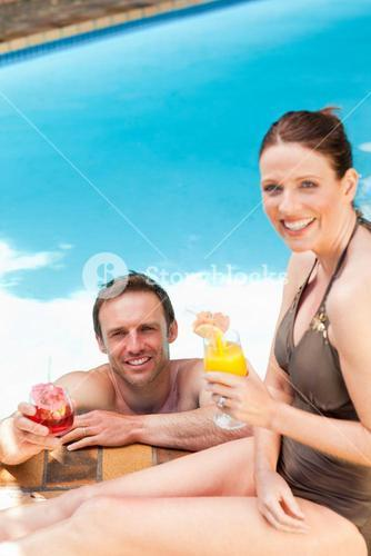 Smiling couple drinking cocktails