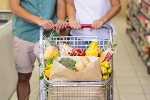 Bright couple buying food products