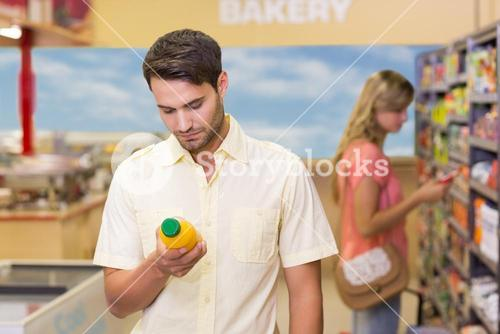 A handsome man buying products