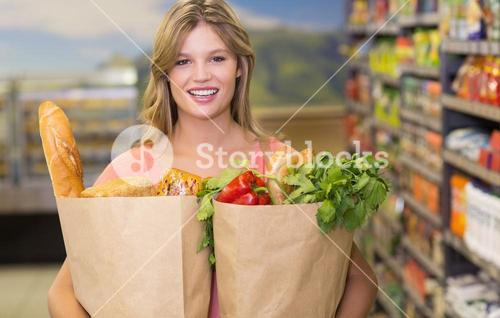 Portrait of pretty blonde woman buying food products