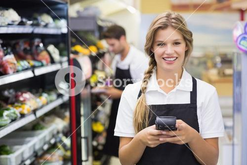 Portrait of smiling pretty blonde woman using handheld