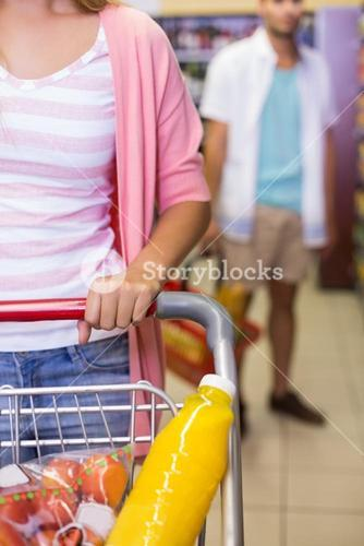 A young pretty woman buying a food products