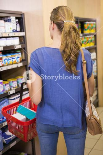 Rear view of woman doing shopping