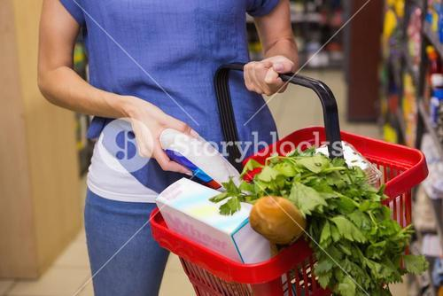 Woman putting product in basket