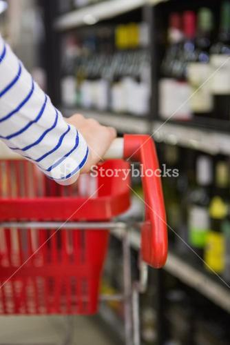 Close up view of hand of woman on trolley