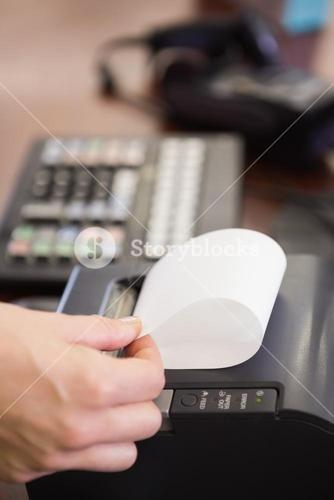 Hand of woman taking receipt