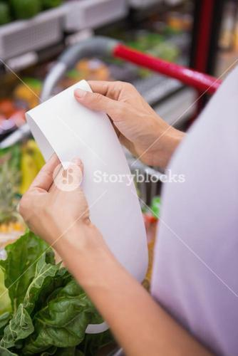 Woman reading her shopping list