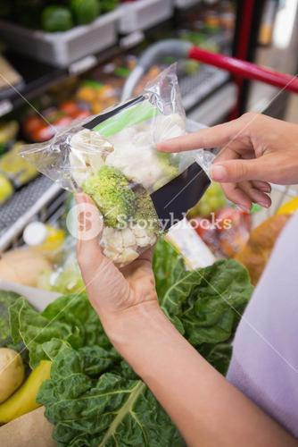 Woman hands pointing at broccolis