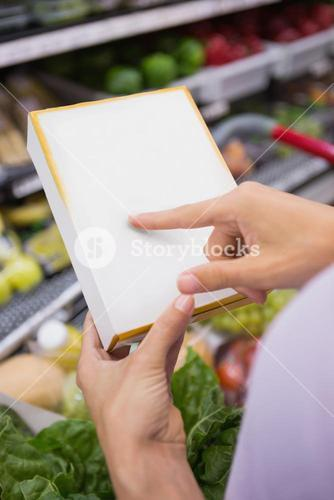 Woman pointing her shopping list