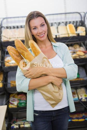 A woman buying bread in the pastries shelf