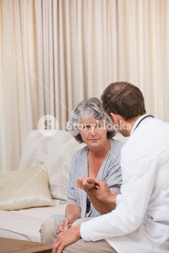 Doctor talking with his partient