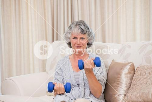 Woman doing her exercises on her sofa