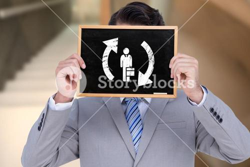 Composite image of businessman showing board