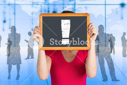 Composite image of woman covering face with chalkboard