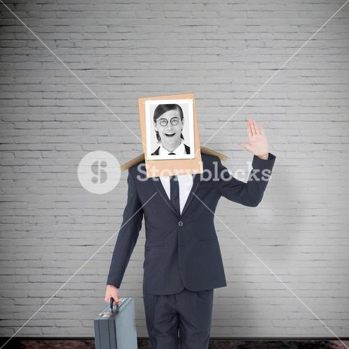 Composite image of businessman with photo box on head