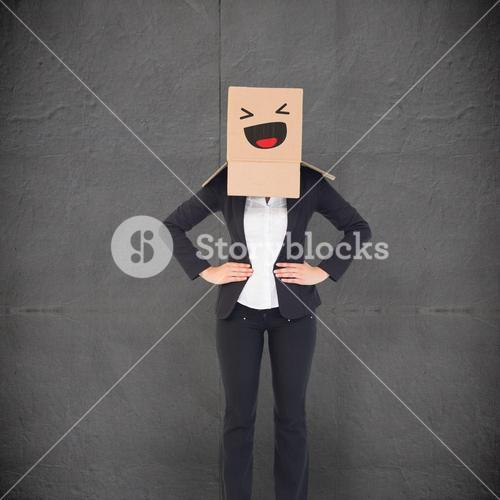 Composite image of businesswoman with box over head