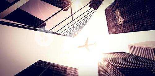 An airplane flying over buildings