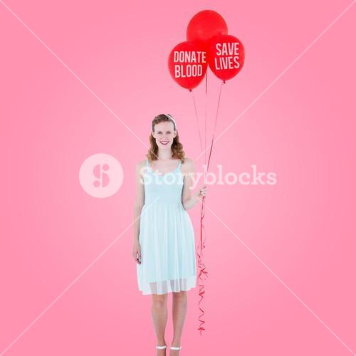 Composite image of happy hipster woman holding balloons