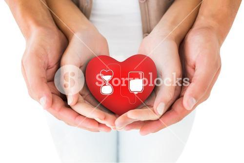 Composite image of couple holding miniature heart in hands