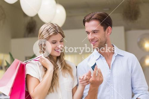 A happy couple looking at beauty product