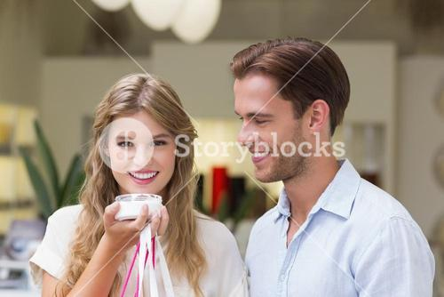 A couple testing a sample of beauty products