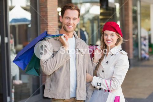 A happy couple with shopping bags