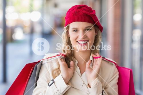 Portrait of a happy smiling woman with shopping bags