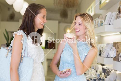 Happy women trying cosmetic products
