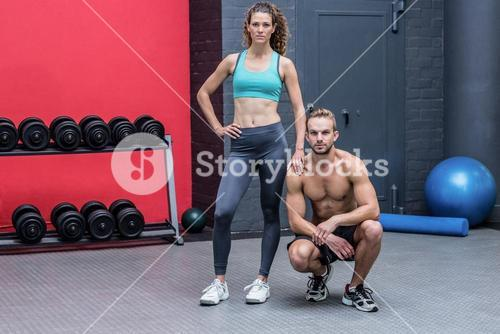 Standing and kneeling muscular couple