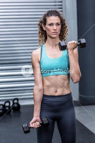 A muscular woman lifting weights