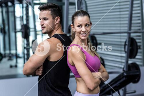 Muscular couple giving back to back
