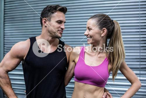 Muscular couple looking at each other