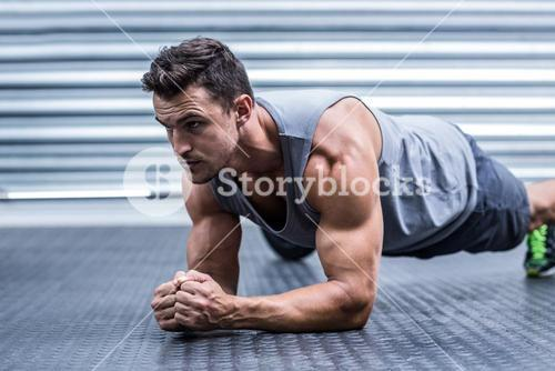 A muscular man on plank position