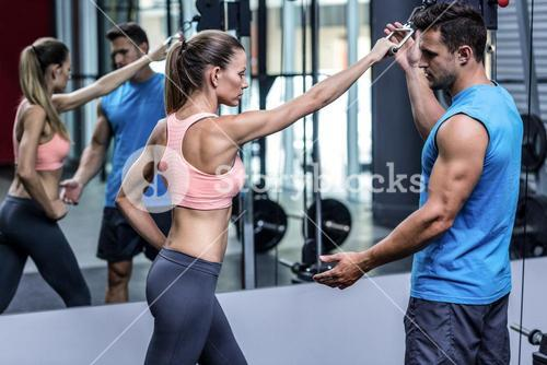 Muscular woman doing pulling exercises