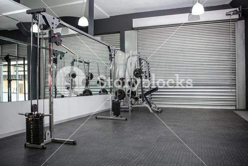 Exercise room with shutters and mirrors