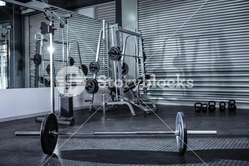 Heavy barbell in empty room