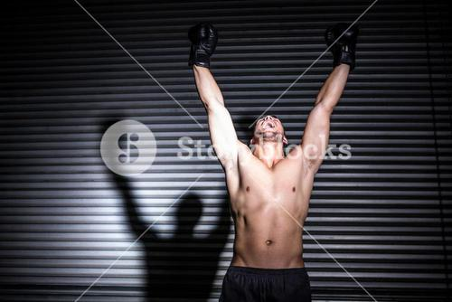 Muscular man punching in the air