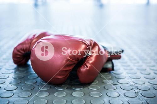 Close up view of boxing gloves on industrial floor