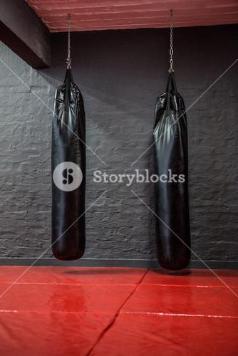 Two punching bags in red bowing area