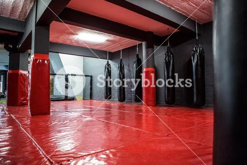 Red boxing area with punching bags