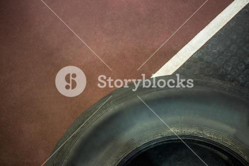 Close up view of tire next to race track
